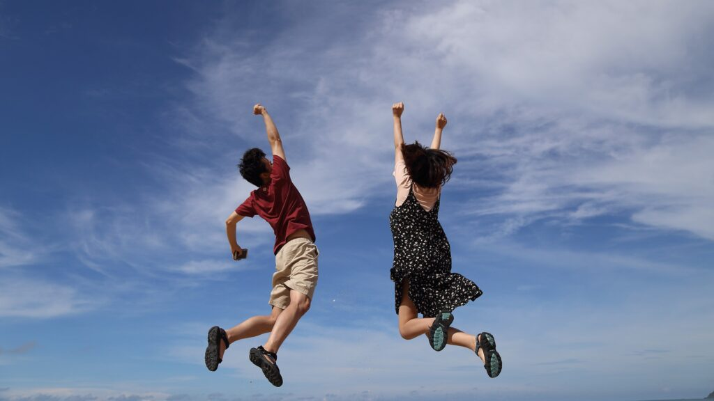 Ambassador Banner Image two people jumping for joy